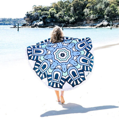 Cobra Round Towel over her shoulders on the beach