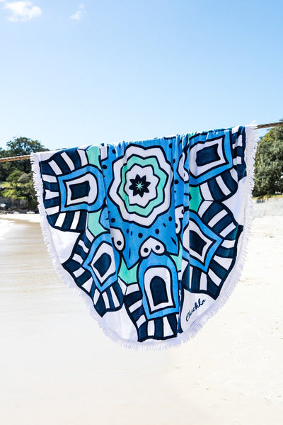 Cobra Round Towel hanging on the beach