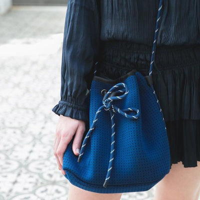 Delia Neoprene Bucket Bag over shoulder close up