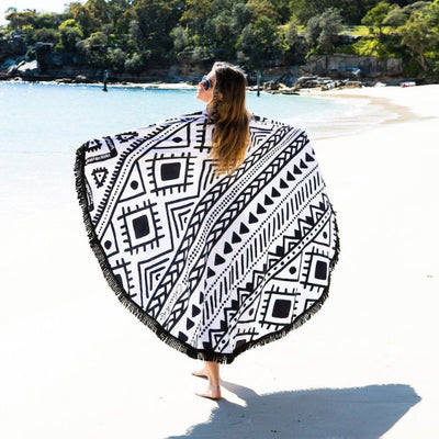 Inca Round Towel over shoulders on the beach