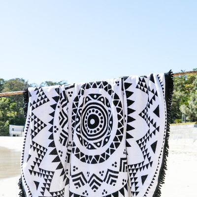 Navajo Round Towel hanging on the beach