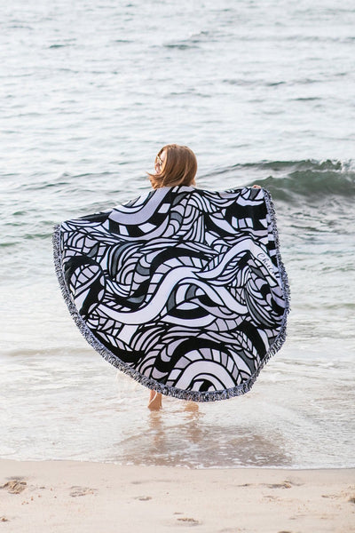 Serpent Round Towel over her shoulders at the beach