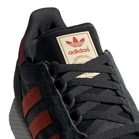 adidas BD7940 Forest Grove in Carbon/ Active Orange/ Easy Yellow Trainers adidas