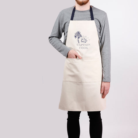 Apron with ship screen print, designed by Curious Lions and made in the UK. This unisex natural cotton item makes a nautical gift.