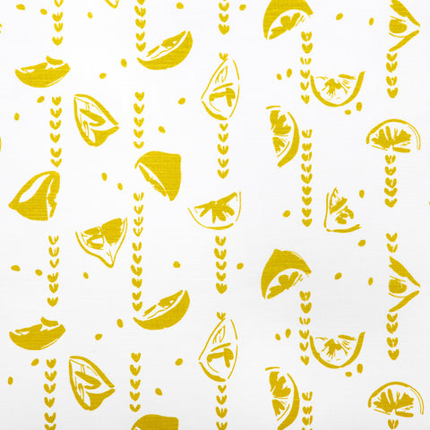 Chartreuse Lemons screen printed fabric sold by the metre.