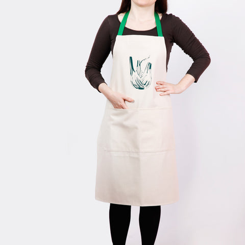 Apron with fennel screen print, designed by Curious Lions and made in the UK. This unisex natural cotton item makes a rustic gift.