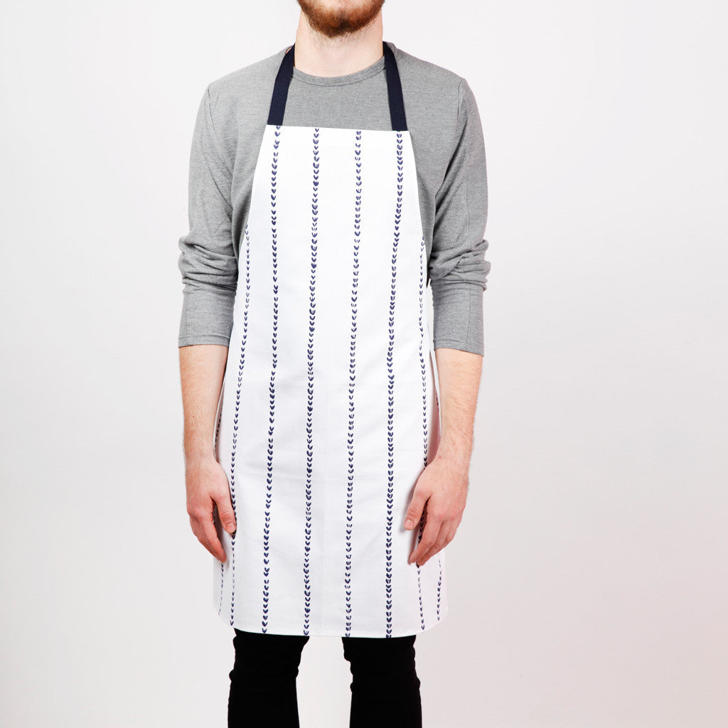 Apron with wheat stripes screen print, designed by Curious Lions and made in the UK. This unisex natural cotton item makes a rustic gift.