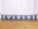 Draught excluder in natural linen with foo dog print: keeps in heat. Designed by Curious Lions and made in the UK. Washable cover and pad.