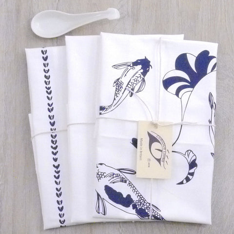 Tea towel set with lucky koi screen print on panama cotton, designed by Curious Lions and made in the UK. These keep their shape and colour.