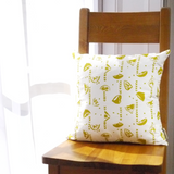 Cushion with removable cover in linen with screen printed lemons design, washable 46 x 46cm. Created and made by Curious Lions in the UK. Keeps it's shape.