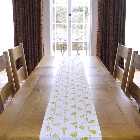 Table runner in linen with screen printed lemons design, washable with hemmed edge 215 x 32cm. Created and made by Curious Lions in the UK.
