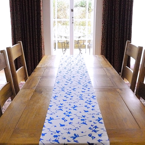 Table runner in linen with screen printed ivy design, washable with hemmed edge 215 x 32cm. Created and made by Curious Lions in the UK.