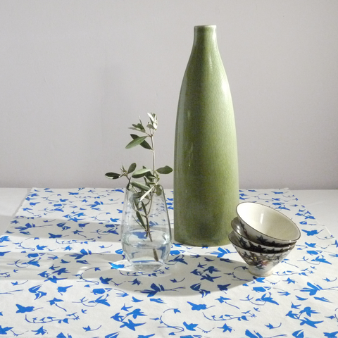 Table topper in linen with screen printed ivy design, washable 70 x 70cm hemmed. Created and made by Curious Lions in the UK.