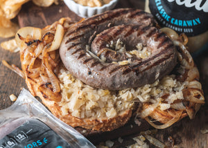 Grilled Boerewors w/ Sauerkraut, Caramelized Onions, and Sourdough