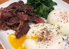 high protein breakfast with eggs, kale and beef biltong