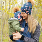Hat with ear covers and pompom - flowers navy