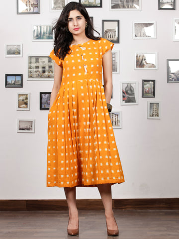 Mustard Ivory Handwoven Double Ikat Pleated Dress With Side Pockets & Tassels - D65F1019