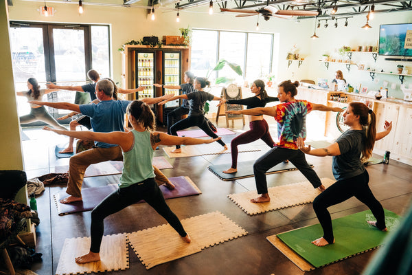 Yoga with CBD - People doing yoga in Asheville Retail Stor