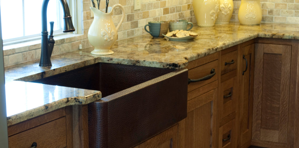 hammered copper sink in traditional kitchen