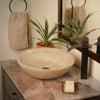 beige travertine vessel stone sink lifestyle