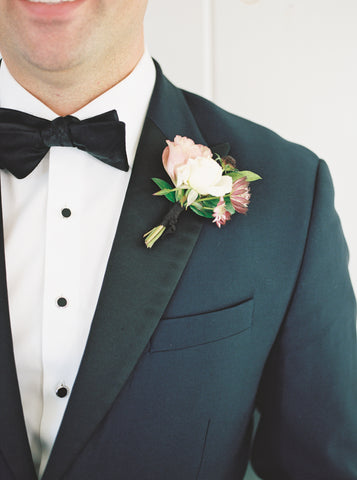 Boutonniere by Old Slate Farm, Black Silk Ribbon by The Lesser Bear Photo Henry Photography as seen in Martha Stewart Weddings