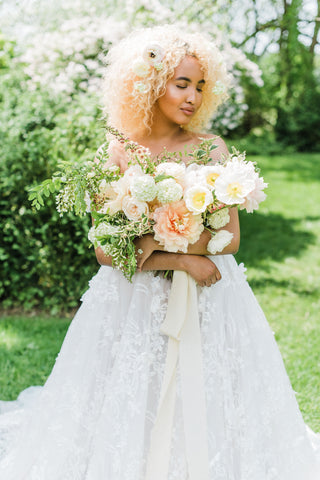 Bride Holding a Bouquet with Naturally Dyed Silk Ribbon by The Lesser Bear Photo by Ashely D Photography Florals Old Slate Farm