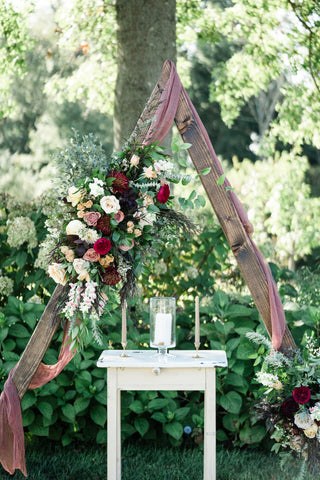 Triangular Ceremony Arch with Naturally Dyed Silk Gauze Drapery and Florals