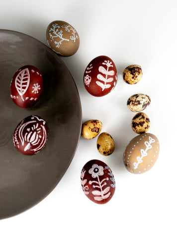 Brown and beige naturally dyed easter eggs with Scandinavian patterns in white by The Lesser Bear