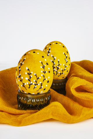 Yellow Naturally Dyed Easter Eggs with black and white botanical illustrations and decorative dots by The Lesser Bear