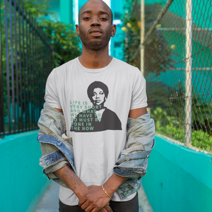 Photo of person wearing Audre Lorde Quote unisex tee