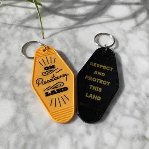 Yellow and black Native Land keychains