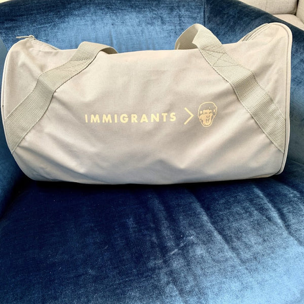 'Immigrants > Trump' Duffel Bag