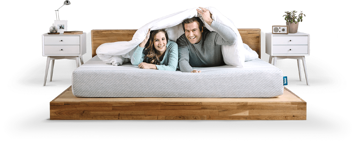couple hiding under comforter on leesa original mattress