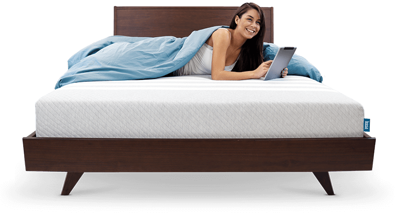 woman using tablet while laying on leesa original mattress