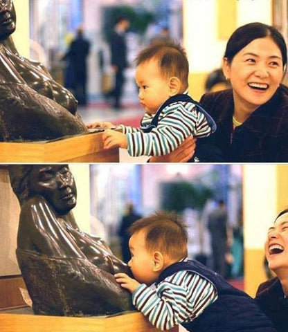 Baby Breastfed By Statue