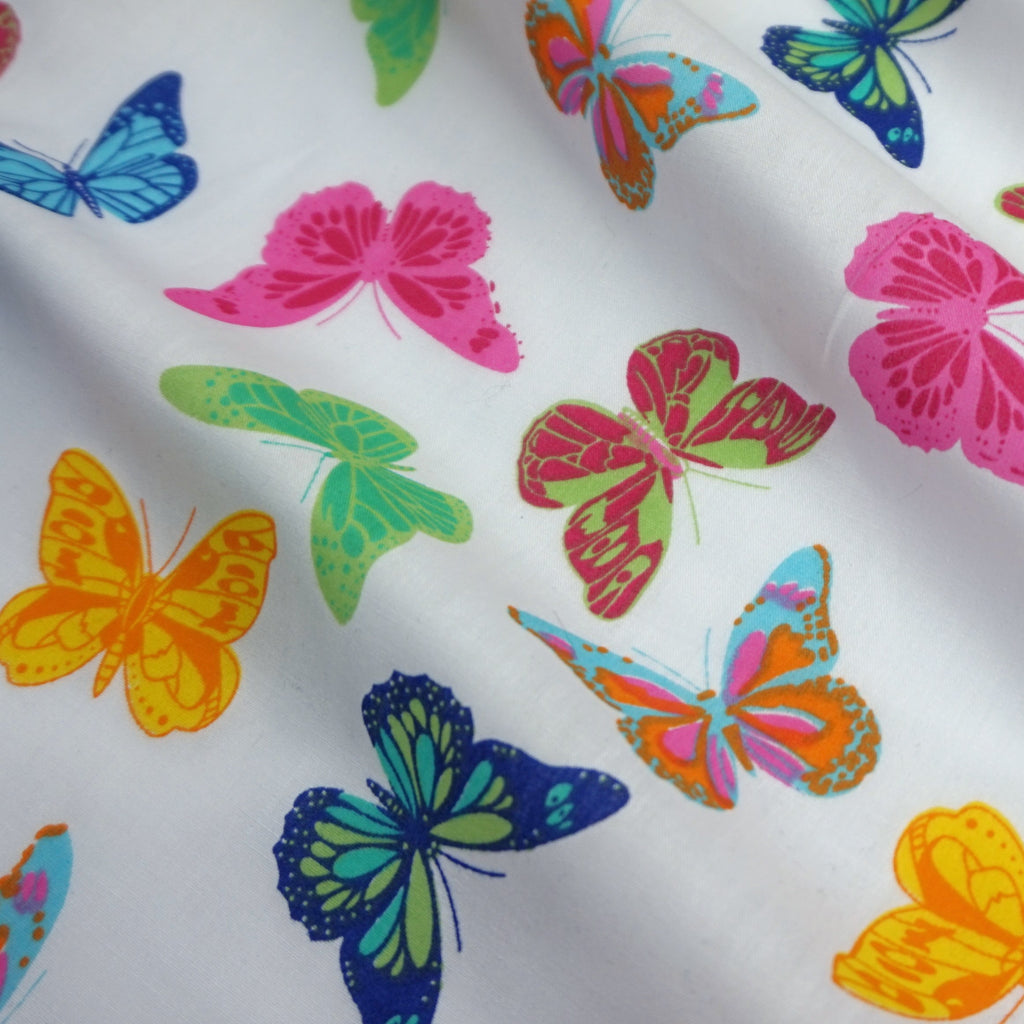 White Polycotton Fabric with Multicoloured Butterflies - Yellow (Per Metre)