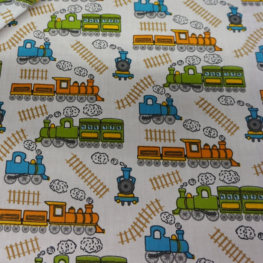 White Polycotton Fabric with Bright Childrens Trains Print - 2 Colours (Per Metre)