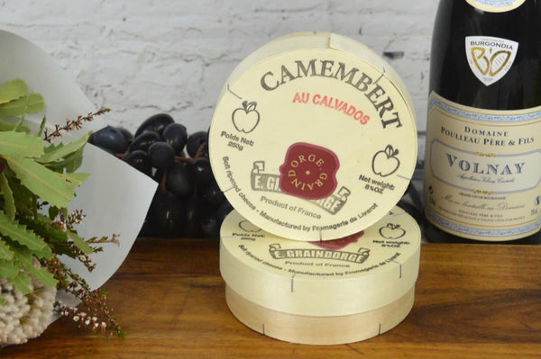 Camembert Calavados French Cheese on a cheeseboard