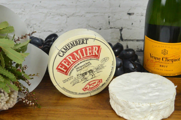 Camembert Fermier French Cheese on a cheeseboard