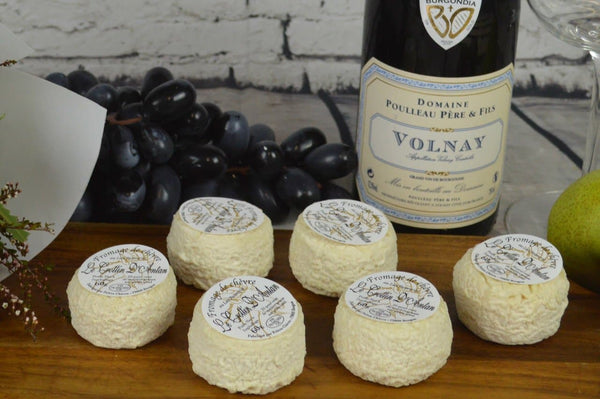 Crottin d'Antan French Goat Cheese on a cheeseboard