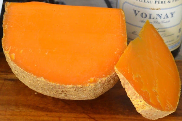 Mimolette French cheese on an cheeseboard