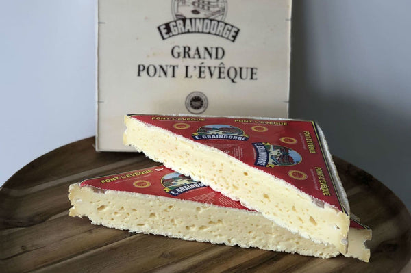 Pont l'Eveque French cheese on a cheeseboard