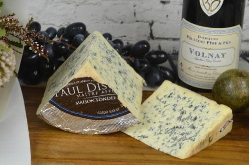 "Bleu D""auvergne AOP French blue Cheese on a cheeseboard"