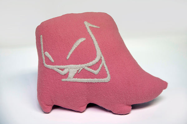 Hand sewn small pink Mr. Fangs plush with hand-embroidered smile in white.