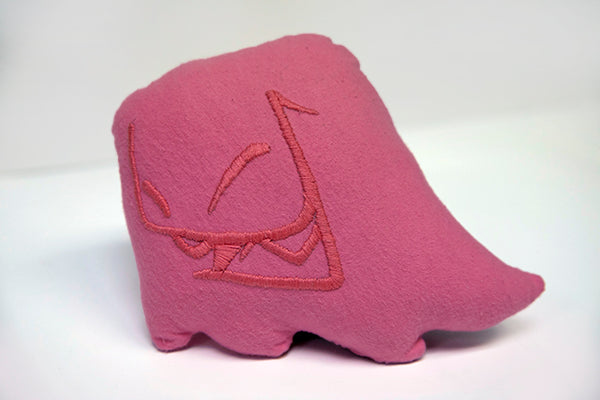 Hand sewn small pink Mr. Fangs plush with hand-embroidered smile in pink.