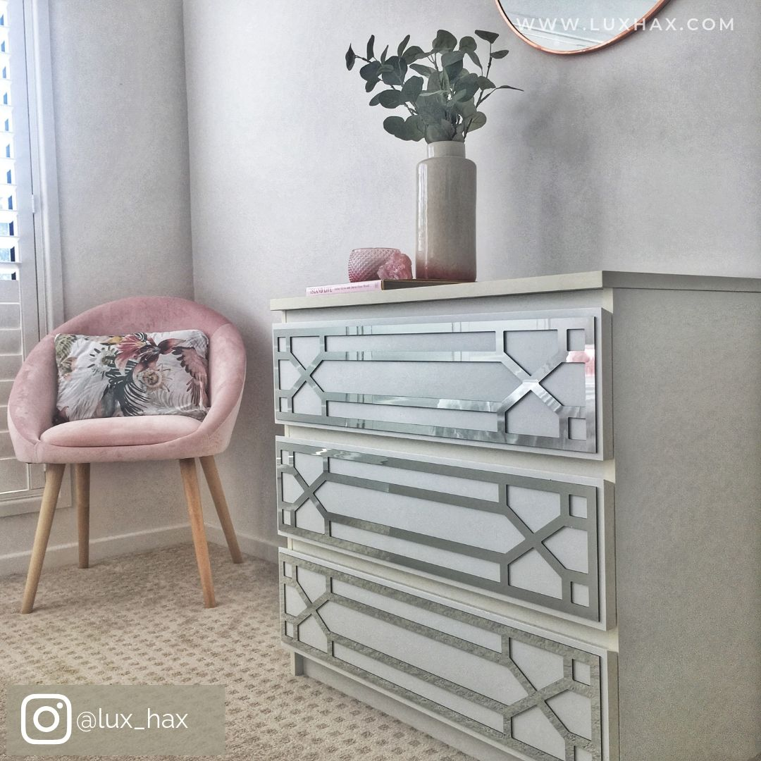 White IKEA drawers with Lux Hax Styl-Panels 1134 in mirrored silver next to pink velvet chair