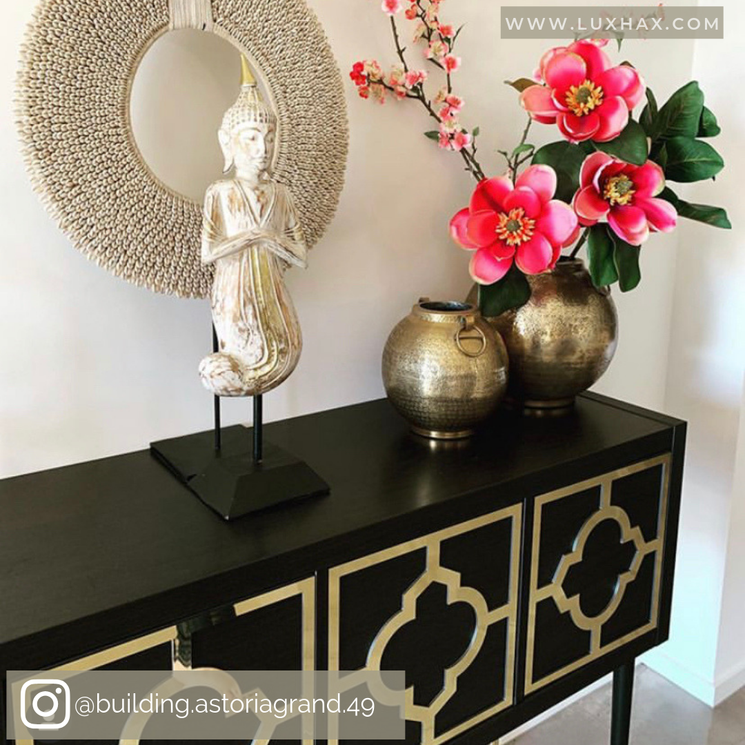 Black sideboard with Lux Hax gold mirrored panels.