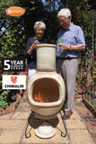 Gardeco Asteria Extra Large Cappuccino Chimalin AFC Chiminea With Burning Fuel Inside In A Garden Setting With 2 People | SKU: AFC-C51.73 | Barcode: 5031599044552