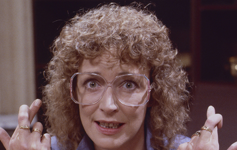 Deirdre Barlow 1980's with huge perm and vintage glasses.