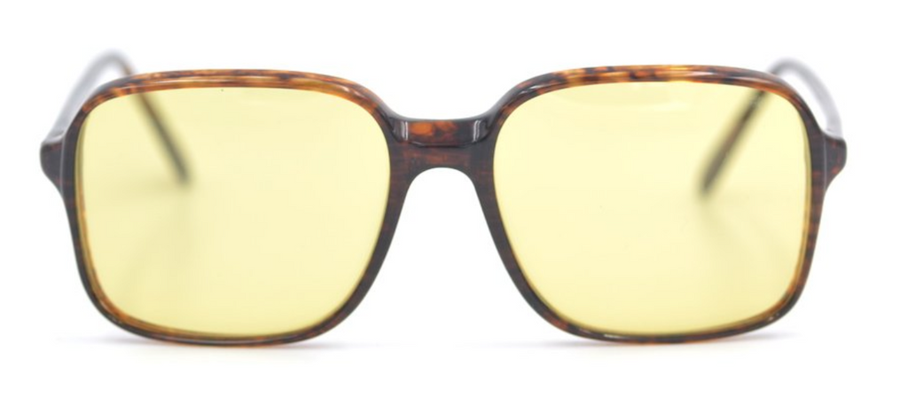 New old stock Luxottica 500 L7 vintage fashion glasses. The frame has been fitted with a yellow fashion tint and the glasses are very similar to that worn by Monique in the Netflix hit The Serpent.